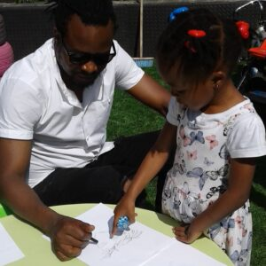 dad drawing his daughter - little blessings nursery south Croydon